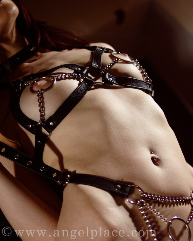 She pulls against the straps of the harness.