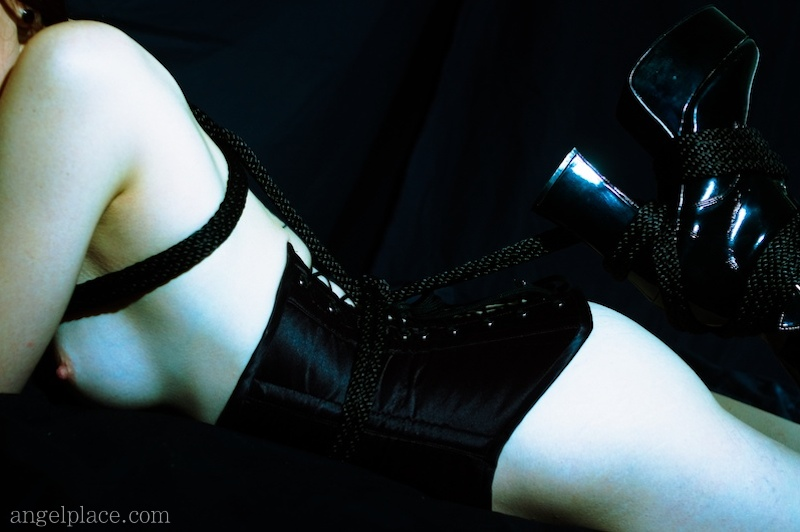 Corset, rope and sexy boots - kinbaku-bi / shibari.