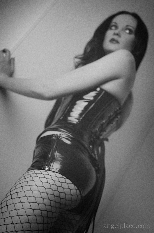 Shiny vinyl: hot pants and bustier/corset. And fishnets.