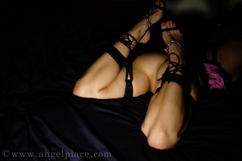 Rope around thighs - kinbaku-bi / shibari.